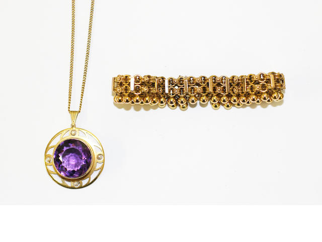 An amethyst and seed pearl pendant and a Victorian gold bracelet