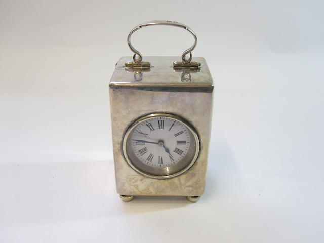 A small silver dressing table clock By Reichenberg & Co, London 1901