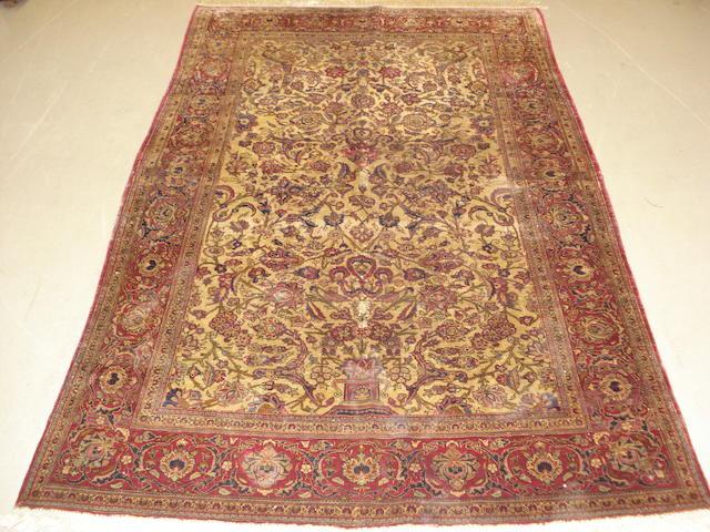 A silk Kashan rug Central Persia, 202cm x 129cm