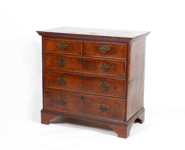 A George II and later walnut feather & cross-banded chest of drawers