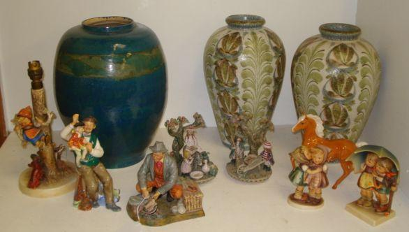 Two Royal Doulton figures, 'Bon Appetit', HN 2444 and 'The Puppet Maker', HN 2253, two Hummell figure groups and a table lamp, pair of Margaret Howard figure groups Autumn Leaves and Donkey Ride, Beswick horse, a Broadstone baluster vase, 36cm, and a pair of Denby inverted baluster vases, 34cm. (11)