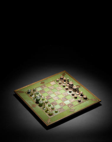 A gold koftgari steel-mounted jadeite and agate Chess Board and Gaming Pieces