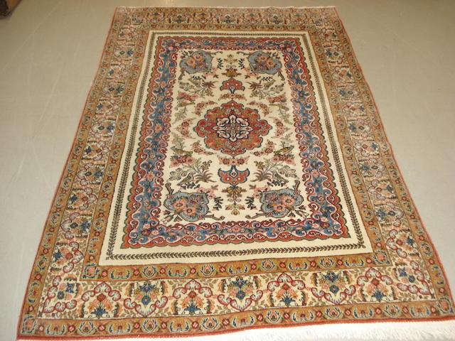 A Ghom rug, Central Persia, 208cm x 135cm