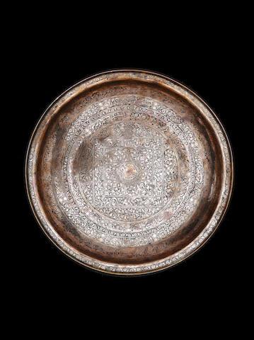 A tinnec copper Safavid dish dated 1141AH owner's name Qwaja Kasi Shah