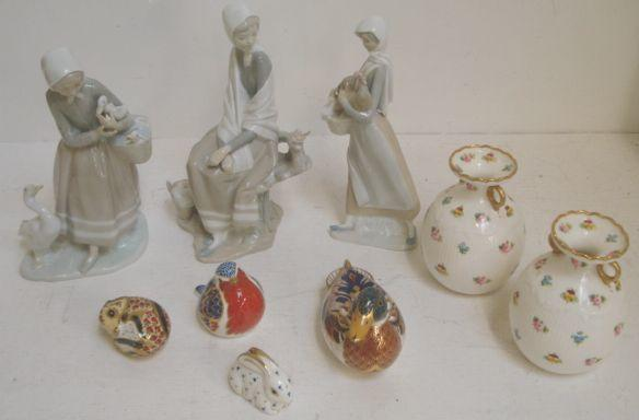 Four Lladro figures, modelled as young women, one holding a chicken, a pair of Mintons baluster vases painted with flowers, and four Royal Crown Derby animal paperweights, boxed.