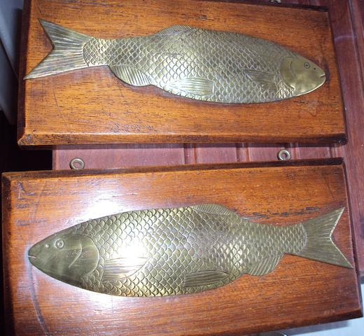 A pair of early 20th century engraved brass relief  profiles of salmon