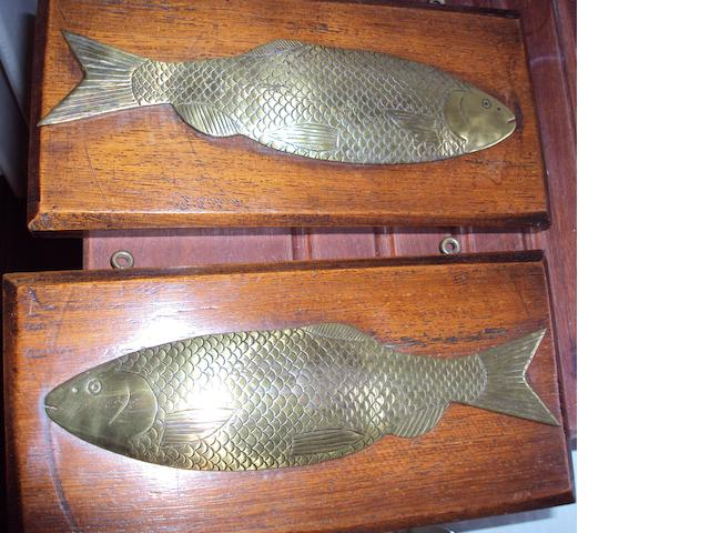 A pair of engraved brass half block models of salmon
