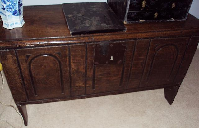 A 17th century carved oak blanket box