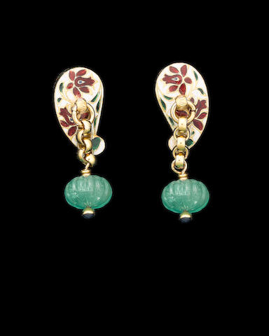 A pair of emerald and enamel cuff links