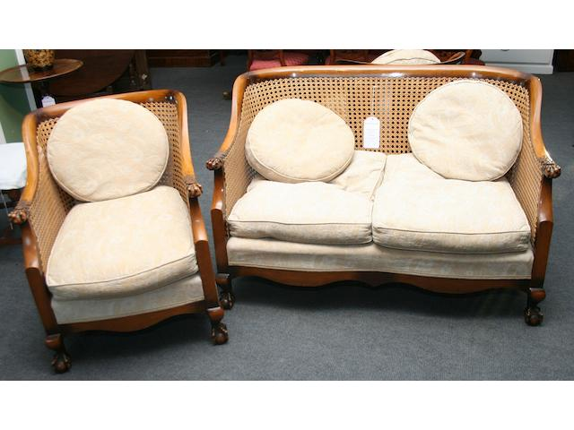 A beech framed three-piece bergere suite