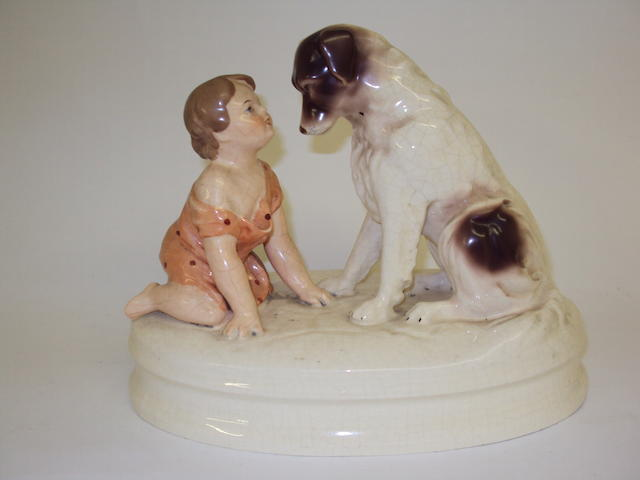 A Royal Dux figure group of a child and dog