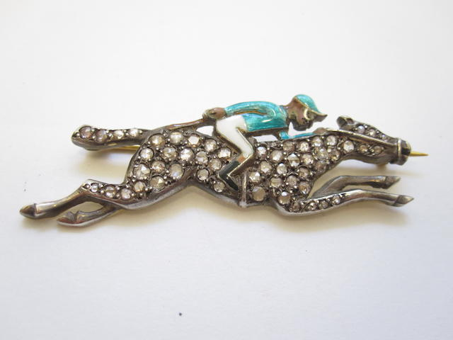 An enamel and diamond horse and jockey brooch