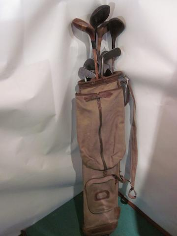 A canvas golf bag trimmed with leather