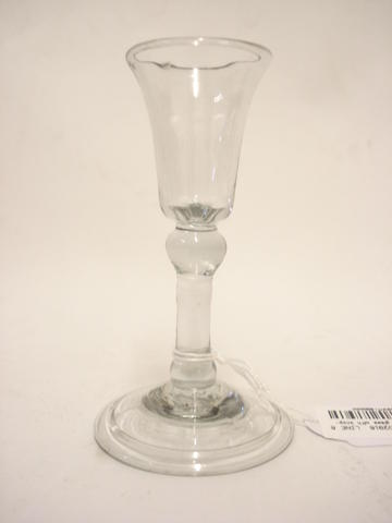 A small cordial glass with knopped stem