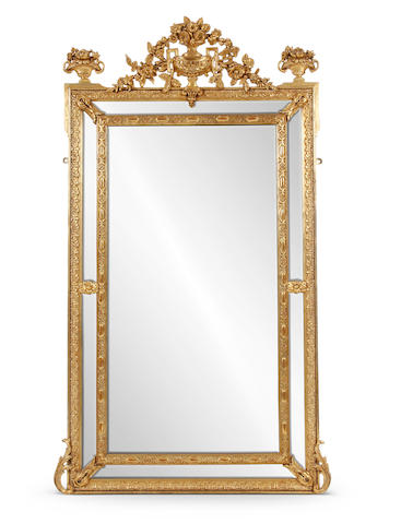 A large giltwood and composition overmantel or pier mirror, early 20th Century