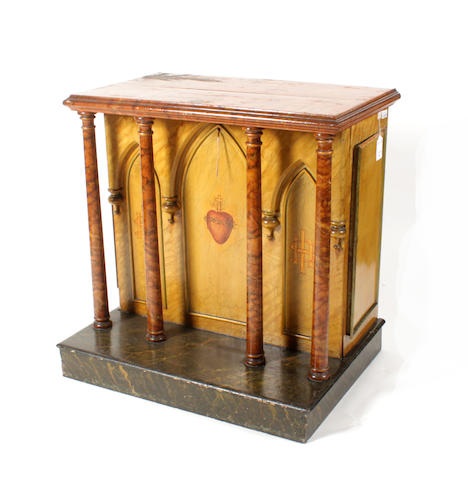 A 19th century painted altar piece