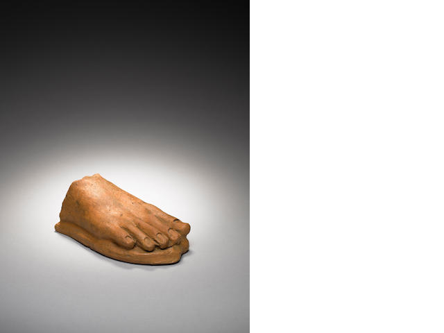 An Etruscan terracotta votive of a right foot