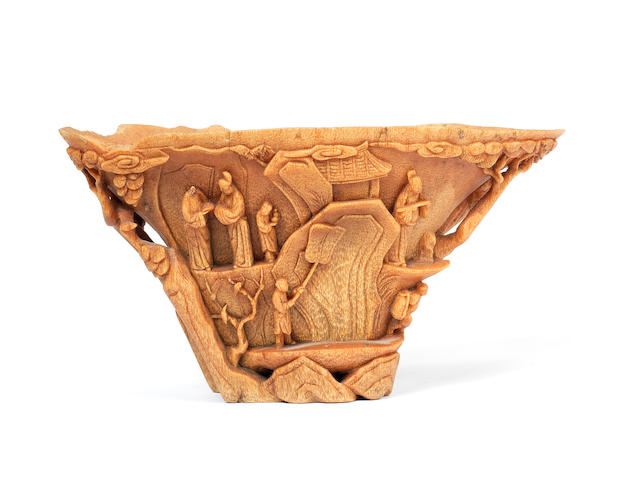 A finely carved rhinoceros horn libation cup 18th century [CHECK]
