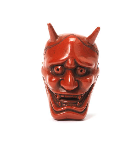 A red lacquer Noh mask netsuke of Hannya By Soso, late 19th century