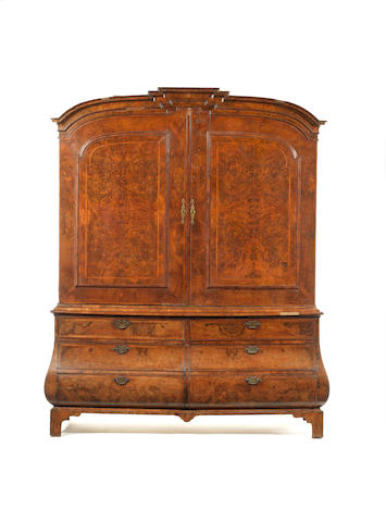 A mid 18th century Anglo-Dutch walnut, crossbanded and featherbanded bombé press cupboard