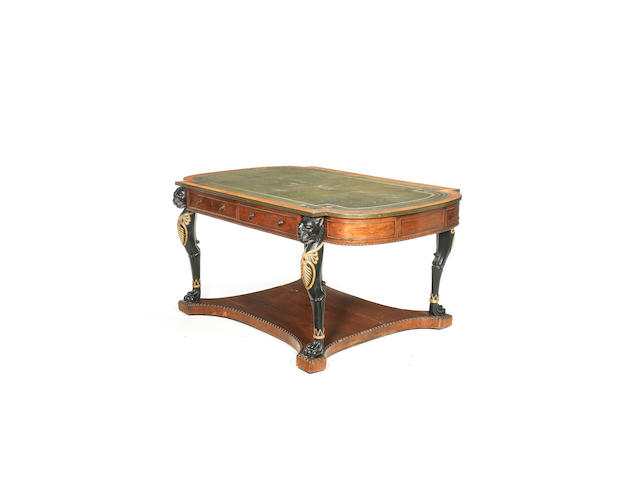 A Regency rosewood, ebonised and parcel-gilt library writing table attributed to Gillows