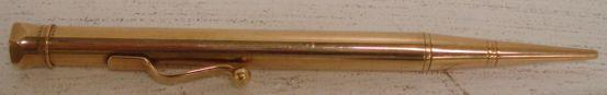 A Dunhill London Baker's Perm-Point 9ct gold cased propelling pencil