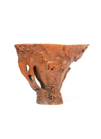 A large and rare carved rhinoceros horn libation cup 17th/18th century