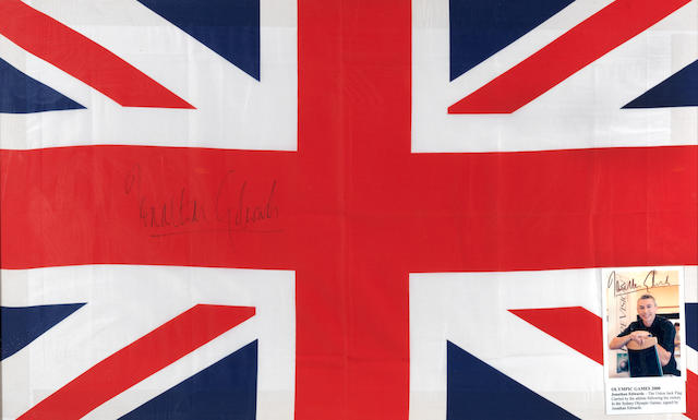 A framed Union Flag, signed by Jonathan Edwards, Sydney Olympiad 2000.