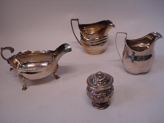 Two George III milk jugs, sauce boat and a pepper