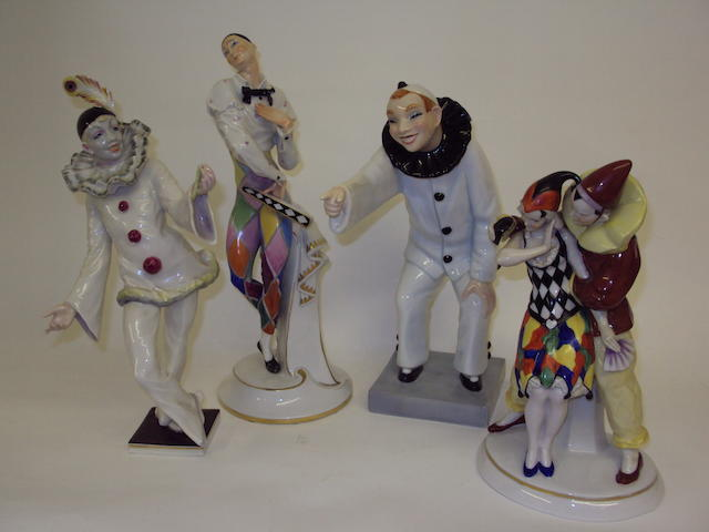 Four Continental clown figure groups