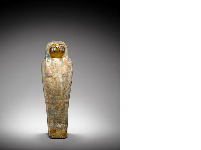 An Egyptian polychrome wood falcon sarcophagus