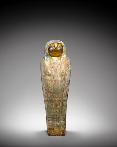 An Egyptian polychrome wood falcon sarcophagus