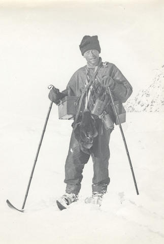 LEVICK (GEORGE MURRAY) A pair of finnesko belonging to Levick; a full-length portrait of Levick laden with camera and instrument cases, with skis and wearing finnesko