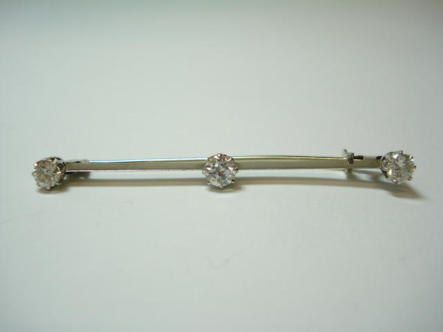 A diamond three-stone bar brooch
