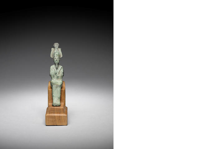An Egyptian bronze figure of Osiris