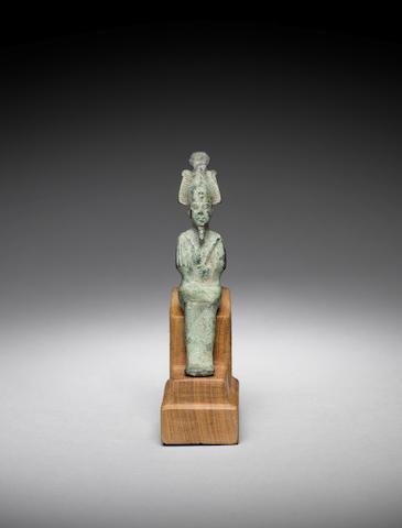 An Egyptian bronze figure of Osiris
