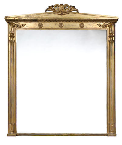 A large Regency carved giltwood overmantel mirror
