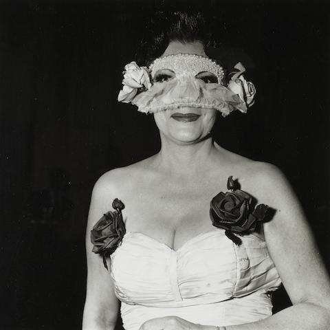 Diane Arbus (American, 1923-1971) Lady at a masked ball with two roses on her dress, N.Y.C., 1967 Paper 50.5 x 40.8 (19 7/8 x 16 1/16in), image 36.8 x 38.8cm (14 1/2 x 14 1/2in).