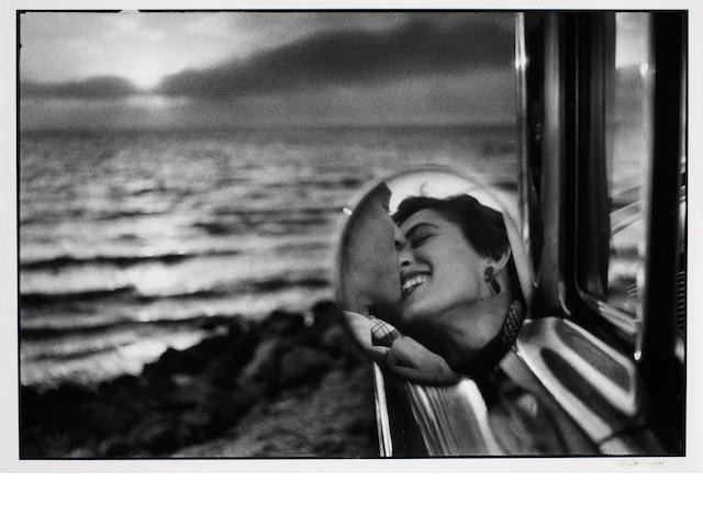 Elliott Erwitt (American, born 1928) California Kiss, 1955 Paper 40.7 x 50.6cm (16 x 19 15/16in), image 31 x 46cm (12 1/4 x 18 1/8in).