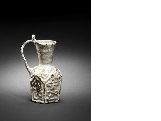 A mould blown glass jug with kufic inscription (assuming intact)