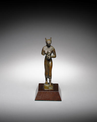 An Egyptian bronze figure of Bastet