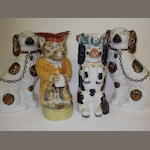 A pair of Staffordshire spaniels and Staffordshire dog and cat jugs