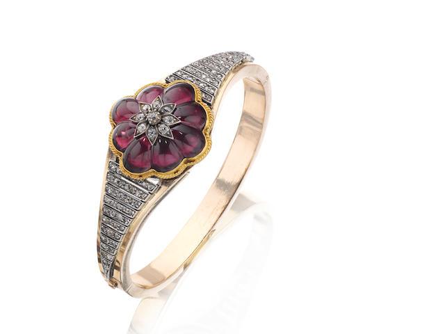 A garnet and diamond bangle