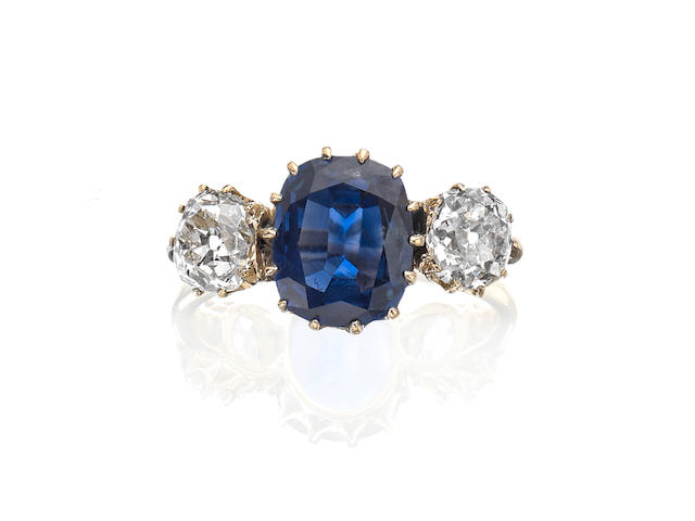 A sapphire and diamond three-stone ring