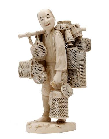 A Japanese ivory sectional okimono of a basket pedlar Meiji/Taisho Period