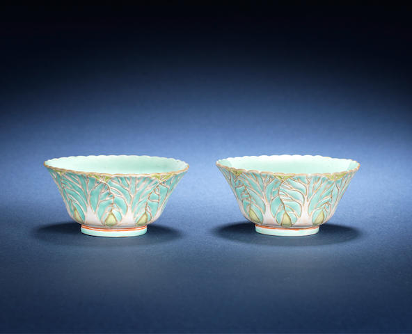 A pair of polychrome 'cabbage leaf' cups Jiaqing seal marks and of the period