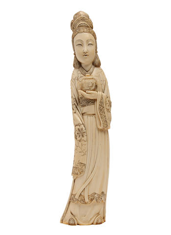 A Chinese ivory tusk carving of Guanyin Late 19th/early 20th Century