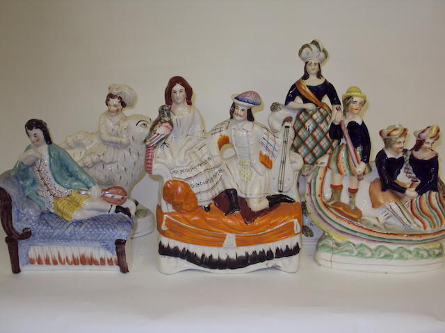 A collection of Staffordshire figure groups