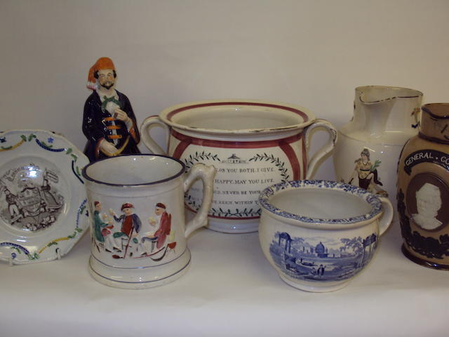 A collection of Staffordshire jugs and pots
