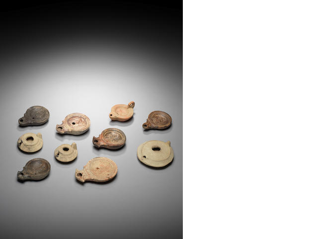 Ten ancient terracotta oil lamps